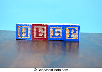 cube the word HELP on wooden background