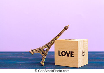 cube wooden block with alphabet building the word love