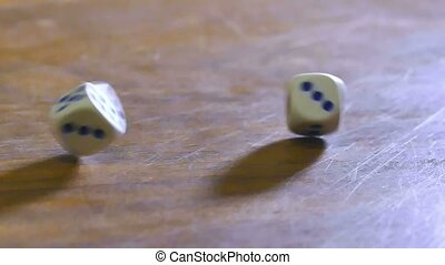 cubes dice fall on table, slow motion video
