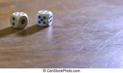 cubes dice fall on the table, slow motion video