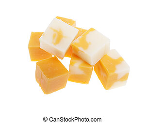 cubes of cheddar cheese isolated on white - cubes of marble...