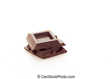 Cubes of dark chocolate white background