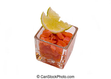 Cubes of smoked salmon on white background