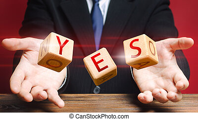 Cubes thrown by a man make up word YES. Agreement and acceptance, answer the question. Courage, irresistibility, zeal forwards, consent. Confirmation and approval. Important decision. Correct answer