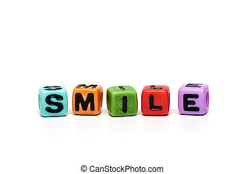 cubes with letters - smile - word made from multicolored...