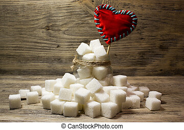 cubos açúcar, e, um, vermelho, ame coração, em, frasco vidro, ligado, madeira, fundo