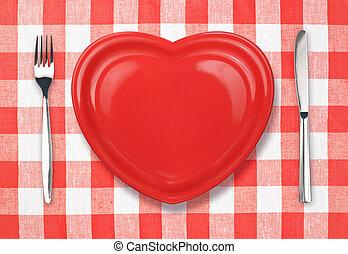 cuchillo, placa roja, y, tenedor, en, comprobado, mantel