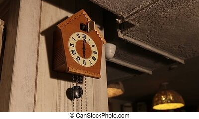 Cuckoo clock, old cuckoo clock on the wall, retro clock