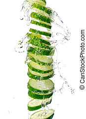 Cucumber - A slice of cucumber in the splash of water. ...