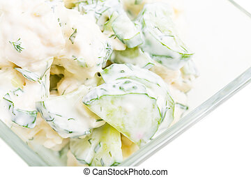 Cucumber and cauliflower salad with sour cream.