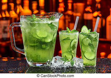 cucumber cocktail - fresh summer coctail in ice by cucumber