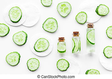 Cucumber cosmetics pattern. White background top view copyspace