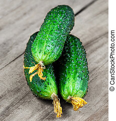 Cucumber on wooden table close up