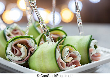 Cucumber rolls with ham and cheese