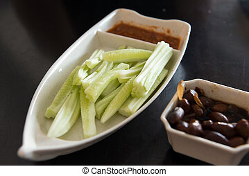 Cucumber salad and braised peanut over black background