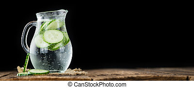 Cucumber Water on vintage wooden background