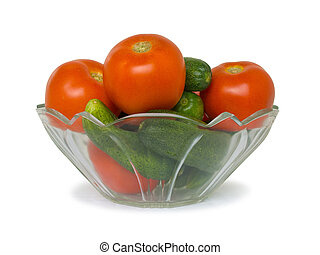 Cucumbers and tomato in bowl