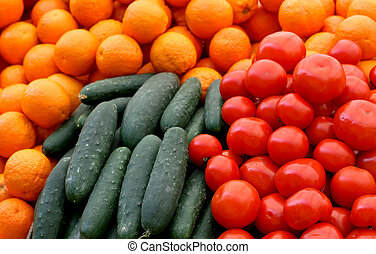 Fresh green cucumber and red organic tomatoes
