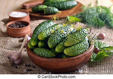 Cucumbers in wooden bowl