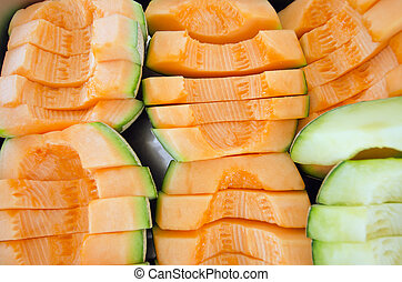 Cucumis melo or melon series in steel tray (Other names are cantelope, cantaloup, honeydew, Crenshaw, casaba, Persian melon, and Santa Claus or Christmas melon)
