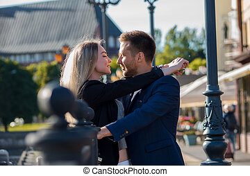 Cuddle. Loving couple on a background of romantic old European city