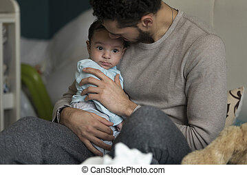 Cuddles with daddy - Young father having cuddles with his...