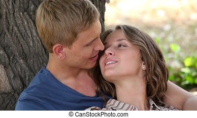 Cuddling and flirting - Carefree summer couple having a good...