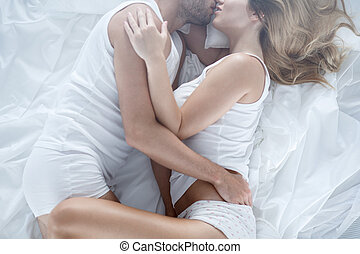 Cuddling in bed - Photo of loving couple cuddling in bed