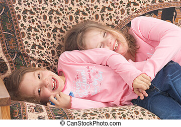 cuddling - two girls on couch