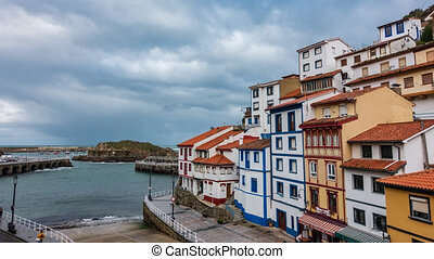 Cudillero fishing village near port time lapse in a cloudy ...