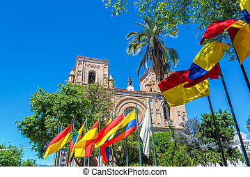 Cuenca, Ecuador Cathedral - Flags waving in front of the...