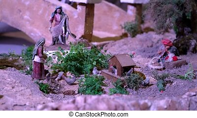 Largest animated nativity scene in South America. Woman...