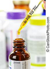 cuentagotas de la medicina, botella