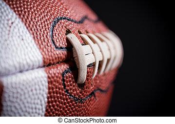 cuero, fútbol americano, fondo negro