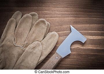 cuero, seguridad, construcción, guantes, y, surfacer, en, tablero de madera