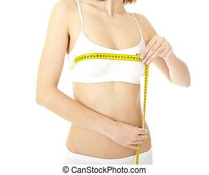 cuerpo de mujer, cuidado, y, amarillo, medida, en, muslos