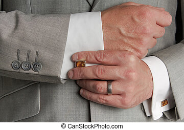 Cuff link Adjustment - Close up of man in business suit...