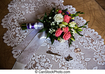 cuff links, tie clasp to lie on a white background bouquet of pink and white roses, groom's fees, the preparation for the wedding, style, infinity sign of the rings, wedding rings on a white background,wedding bands