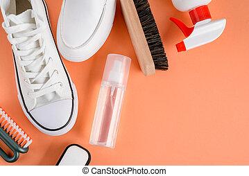 cuidado, calzado, blanco, fondo anaranjado, zapatillas, ...