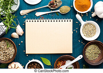 culinary background and recipe book with various spices on ...