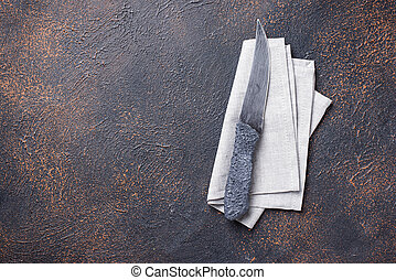 Culinary background with knife and napkin