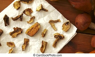 dried mushrooms on baking paper - culinary, food and cooking...