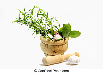 Culinary herbs with mortar on light background
