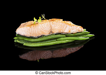 Culinary salmon. - Delicious grilled salmon steak on green...