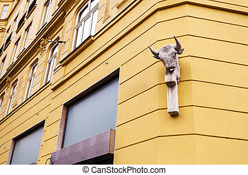 culpture on wall of apartment house in Brno town