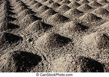 Cultivated land ground piles of soil agriculture abstract...