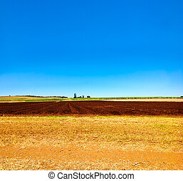Cultivated ploughed field in farm agriculture area