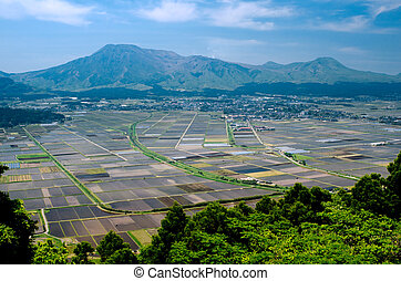 Cultivation area and mountains - Cultivation area in front ...