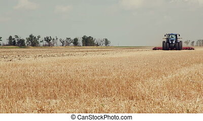 Cultivation tractor acreage. Tractors preparing land for sowing