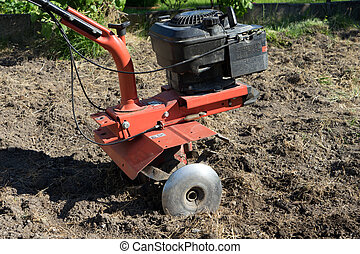 Cultivator - tiller to dig in a garden